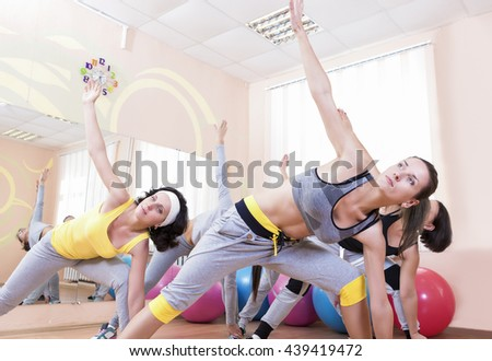 Sport and Healthlife Concepts. Group of Five Young Caucasian Females Making Stretching Exercises in Sport Class.Horizontal Image Orientation - stock photo