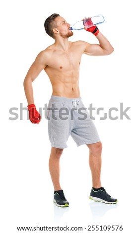 Sport attractive man wearing boxing bandages and drinking fresh water on the white background