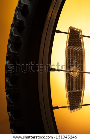 Sport bicycle tire on the orange - stock photo