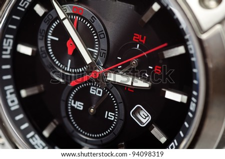 Sport black and red wristwatch. Studio macro shot - stock photo