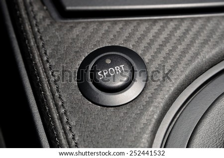 Sport butten from a car console. - stock photo