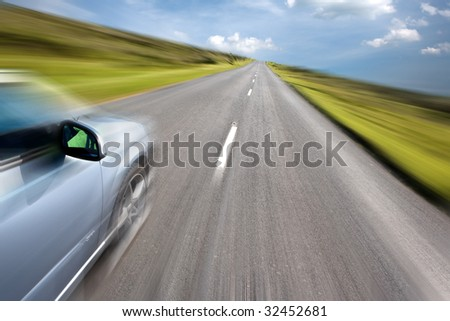 Sport car driving at high speed in empty road - motion blur - stock photo