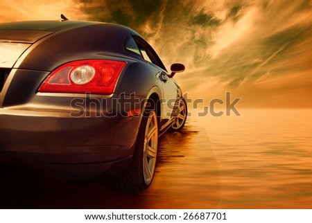 Sport car reflected in water - stock photo