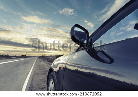 Sport car ride on road in sunset weather VINTAGE - stock photo