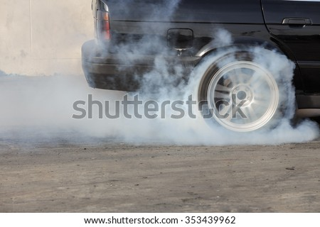 sport car wheel drifting and smoking on track - stock photo