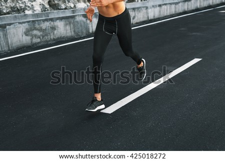 Sport. Close Up Of Sporty Male Legs In Sportwear And Sneakers Running On Road. Healthy Active Athletic Runner Man Jogging During Outdoor Workout, Exercising And Training For Marathon. Fitness Concept - stock photo
