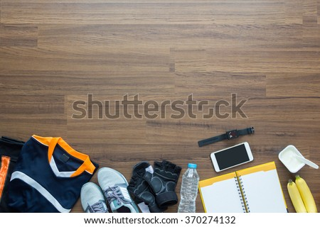 Sport clothes and accessories on a wooden background, View from above with copy workspaces - stock photo