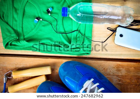 Sport clothes and water bottle. Fitness concept - stock photo