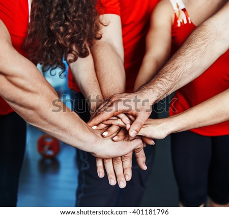 Sport community concept. Fitness aerobics team putting hands on top of each other as symbol of successful collaboration.  - stock photo