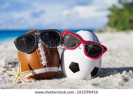 Sport eggs with sunglasses on ocean beach â??easter symbol - stock photo