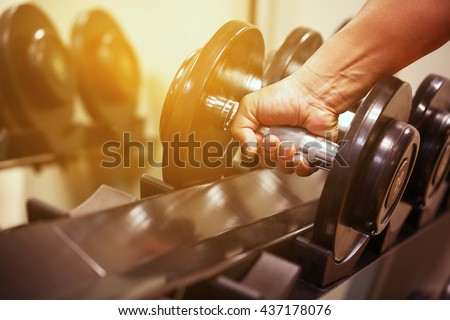 Sport equipment in fitness room or gym room, relax room for healthy people, Dumbbell in fitness and gym room,sport relax and healthy life, favorite sport or private sport in indoor or sport complex. - stock photo