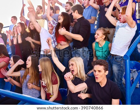 Sport fans clapping and singing on tribunes. Group people of sport fans. - stock photo