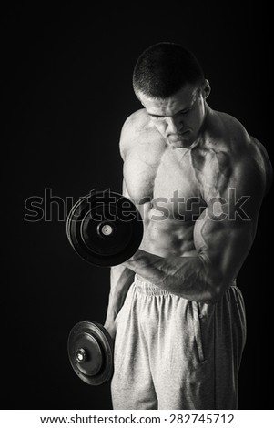 Sport, Fitness and bodybuilding. Subject active lifestyle. Exercising with dumbbells. Technique exercises for biceps. - stock photo