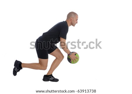 Sport Fitness trainer exercising with a power ball in gym, isolated over white background - stock photo