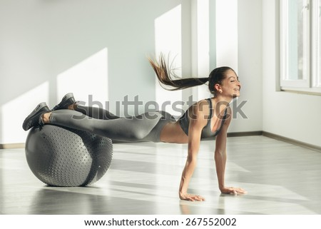 Sport girl doing exercise - stock photo