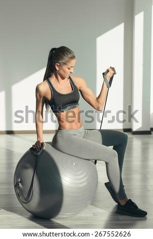 Sport girl doing exercise - stock photo