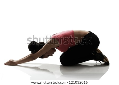 sport girl doing stretching and relaxing exercise, silhouette studio shot over white background - stock photo