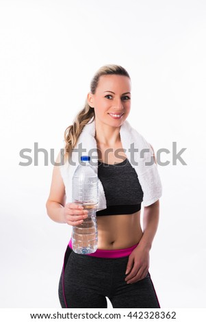 Sport girl with bottle of water and a white towel on a white background