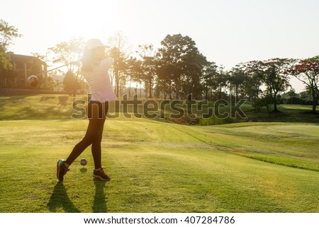 Sport, Golf , People concept - Asian woman golfer hit sweeping golf course in the summer. Asian woman looking enjoy to play golf sport. - stock photo