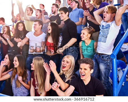 Sport injoying group fans clapping and crying on tribunes.  - stock photo