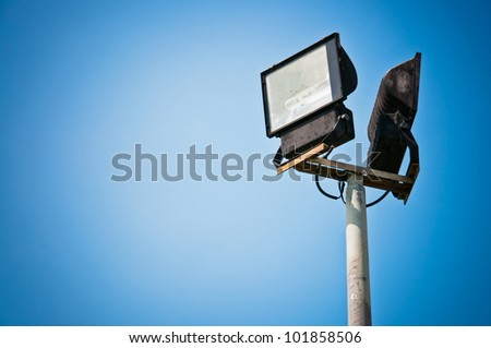 Sport light and blue sky - stock photo