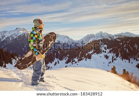 Sport man in snowy mountains at sunset - stock photo