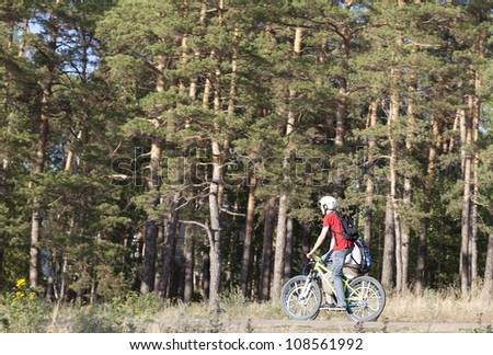 Sport mountain biking happy couple riding downhill in sunny countryside - stock photo