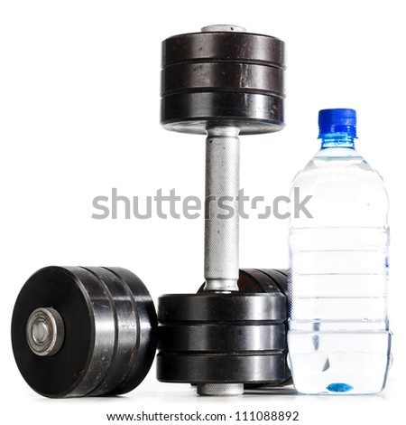 sport nutrition. metal barbells with bottle of water - stock photo