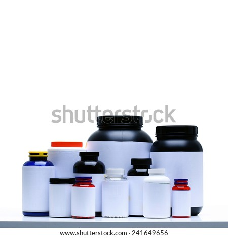 Sport Nutrition Supplement containers isolated on white - stock photo