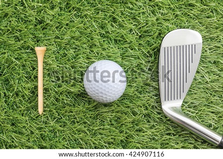 Sport objects related to golf equipment ,Golf club and golf ball on green grass - stock photo