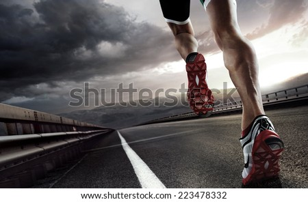 Sport. Runner feet running on road closeup on shoe. - stock photo