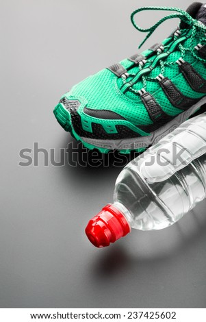 Sport shoe and a bottle of water - stock photo