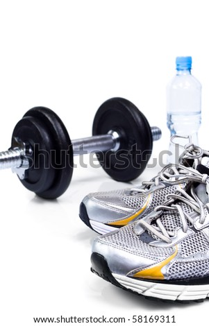 Sport shoes and dumbbell, exercise equipment as fitness concept - stock photo