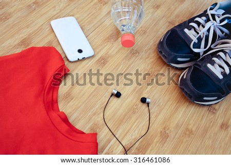 Sport shoes and water with set for sports activities  - stock photo
