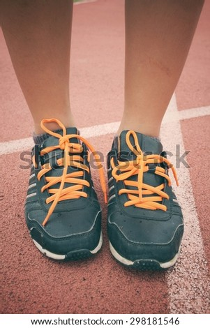 Sport shoes on track