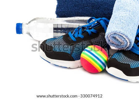 Sport shoes, towels, ball and water bottle isolated on a white background. - stock photo