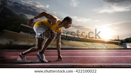 Sport. Sprinter leaving starting blocks on the running track.  - stock photo