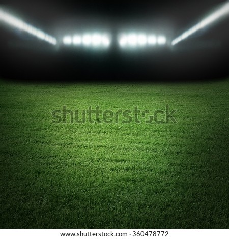 Sport stadium in light of spotlights - stock photo