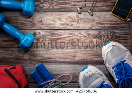 Sport stuff on wooden table, top view