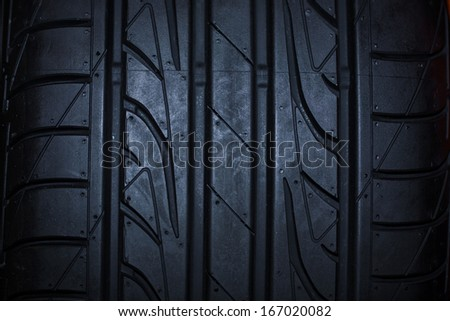 Sport summer car  tire isolated on black background, Close up - stock photo