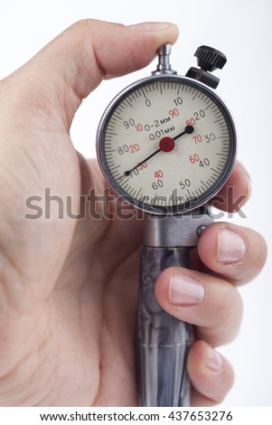 sport timer stopwatch in a man's hand. Isolated on white