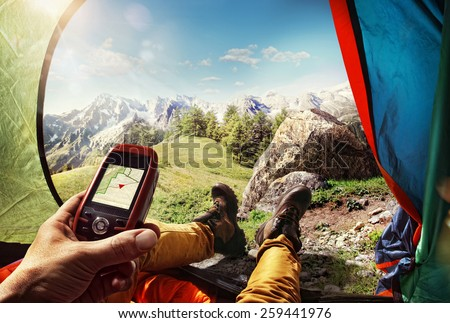 Sport.Tourism. GPS navigator in hand  - stock photo