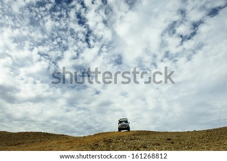 Sport utility vehicle driving in the desert   - stock photo