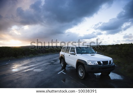 Sport utility vehicle parked on Great Ocean Road in Australia.