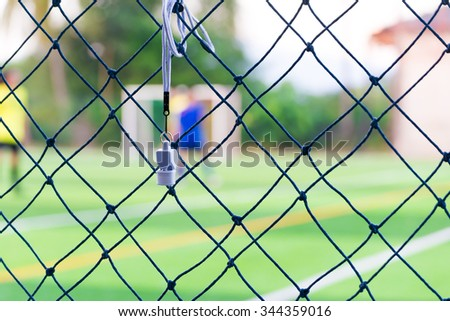Sport whistle on soccer field is background - stock photo