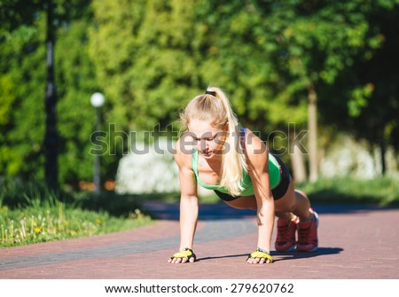 Sport woman doing push-ups during outdoor cross training workout - stock photo