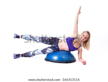 Sport woman exercise with a pilates ball. Isolated on a white background. Studio shot