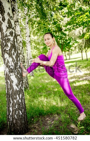 Sport. Woman nature portrait doing exercises. Healthy lifestyle