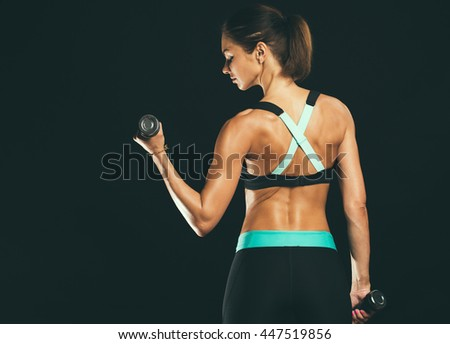 Sport. Woman sport body strong and beautiful. Back view.  - stock photo