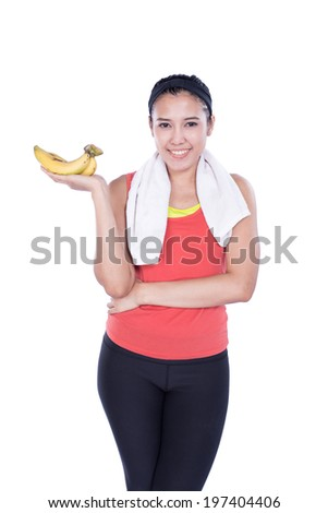 sport woman with banana isolated on white background